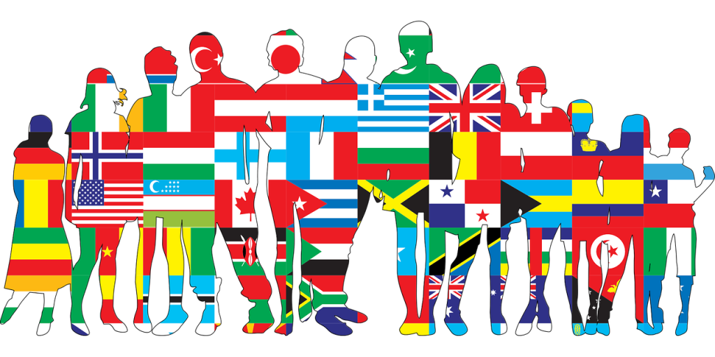 Silhouettes of people standing in a row, covered by flags of different nationalities.