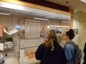 Students viewing library exhibit